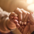 Image of a Man's Hand and a Woman's Holding